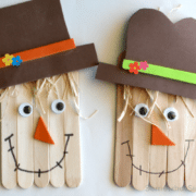 two scarecrow crafts made with popsicle sticks and raffia