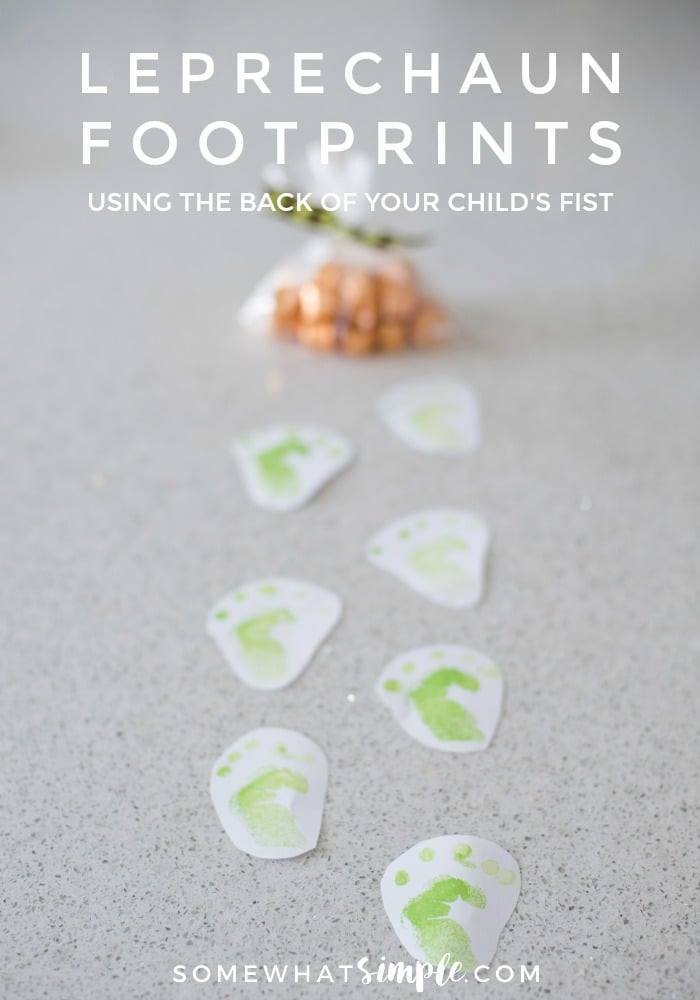 These leprechaun footprints are made by stamping the backside of your child's fist! So simple and fun - your kids are going to LOVE this! via @somewhatsimple