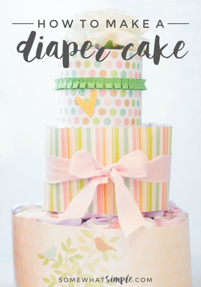 How to make a diaper cake a three layered diaper cake wrapped in paper and ribbon