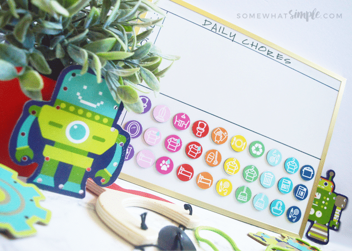 a kids chore chart with colorful chore magnets on it