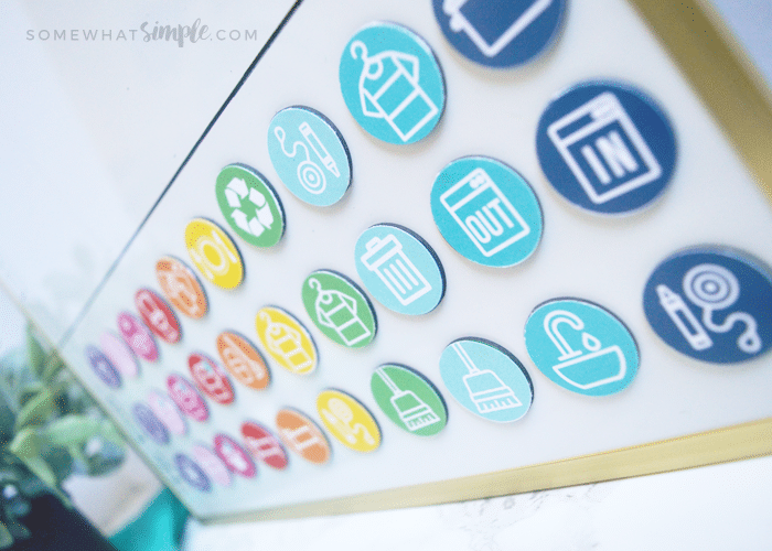a close up of brightly colored magnets that are being used for kids' chores