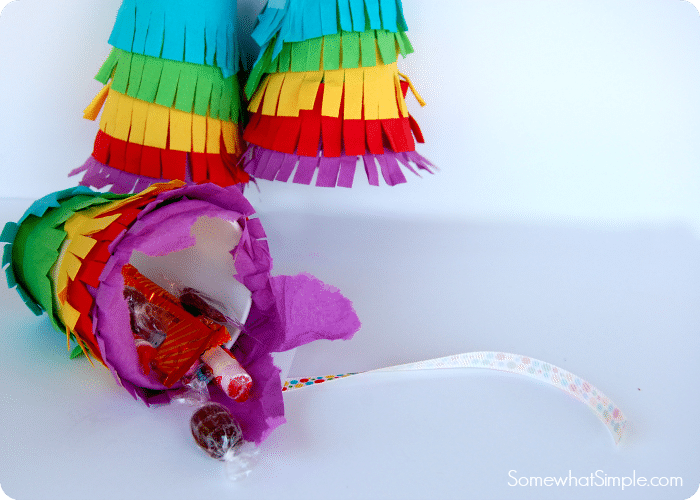these three multi colored mini pinatas are a fun cinco de mayo craft idea for kids