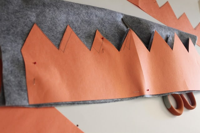 wise man christmas crown construction paper template being placed over grey felt