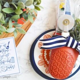 end of the year teacher gift with kitchen gadgets stuffed inside an oven mitt