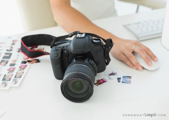 Digital camera on photographers desk in creative office