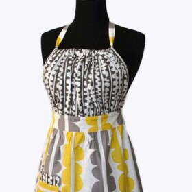 a grey and yellow fabric apron on a mannequin