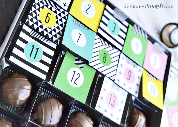 DIY chocolate christmas calendar with tags 1 through 13 covering the chocolates