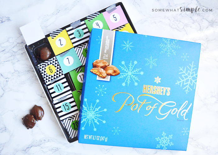 make your own chocolate christmas calendar with a box of hershey's chocolates and this adorable advent calendar printable