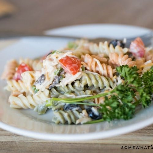 a tri-colored pasta salad made with Italian dressing