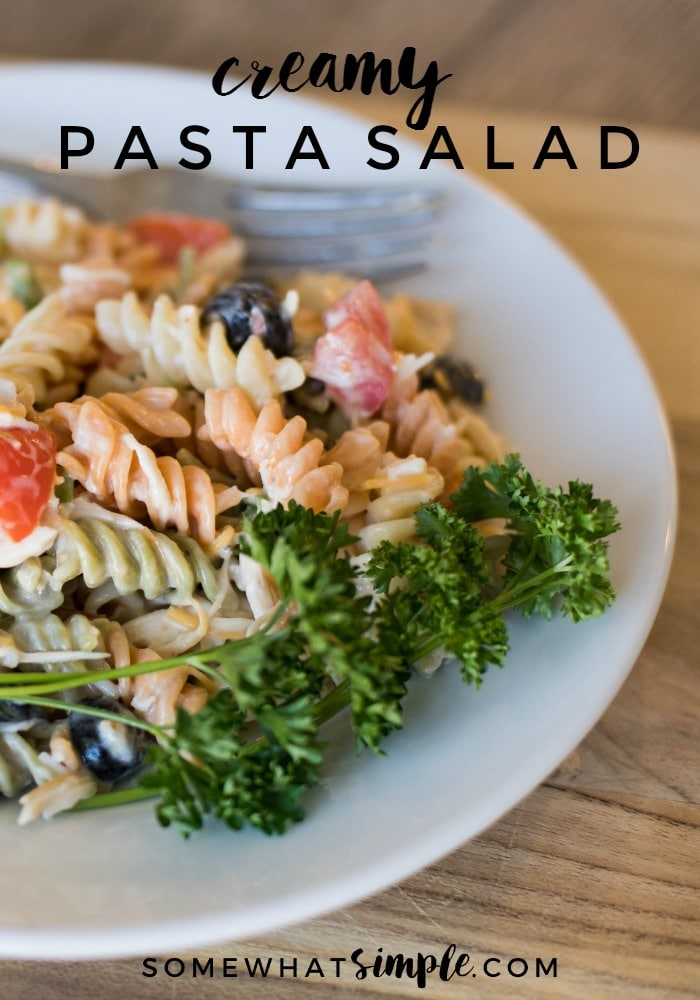 This delicious pasta salad recipe made with Italian dressing has quickly become a family favorite! It is one of the easiest recipes to make and the flavor is amazing!  Simply cook the pasta and toss in a few basic ingredients and you're ready to go. #pastasaladrecipe #bbqrecipe #sidedish #bestpastasalad #pastasaladitaliandressing via @somewhatsimple