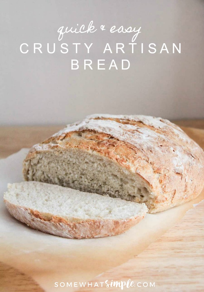 a loaf of Crusty Artisan Bread Recipe with a slice cut off the end and laying on the table