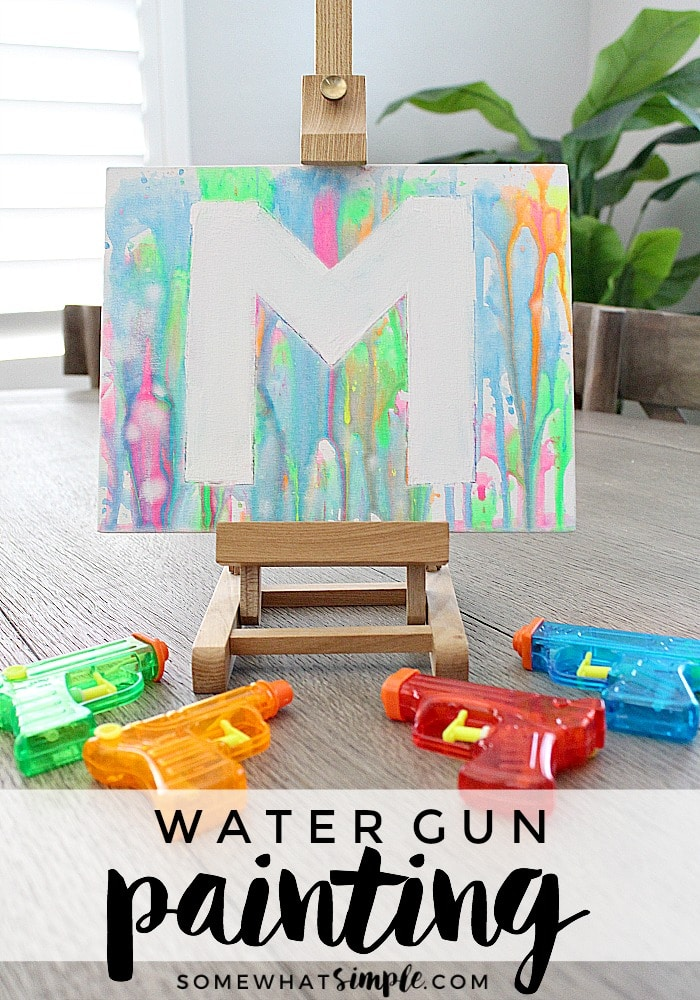 If you're looking for some fun, inexpensive art projects for kids this summer, add painting with water guns to your list! #watergunpainting via @somewhatsimple