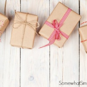 brown paper packages tied up with red ribbon on a white background