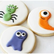 3 sugar cookies with a different monster decorated on each one