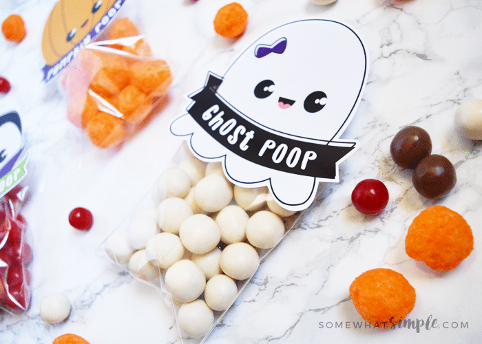 a ghost poop treat bag with white candies inside