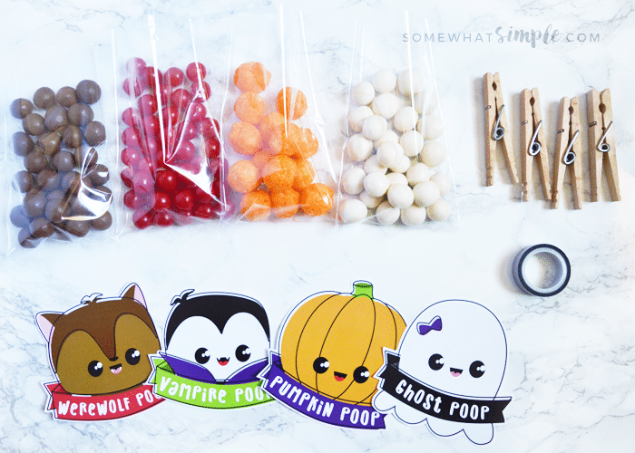 all of the supplies needed to make halloween treat bags