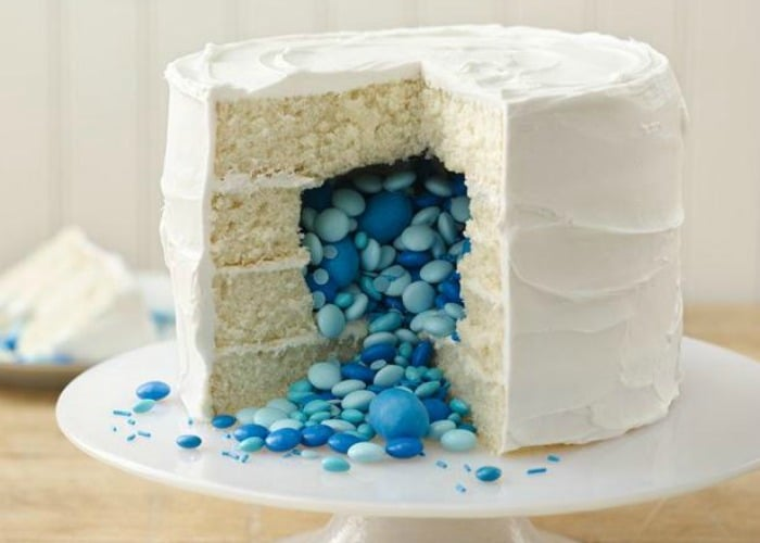 a white cake filled with blue candy is an easy gender reveal idea