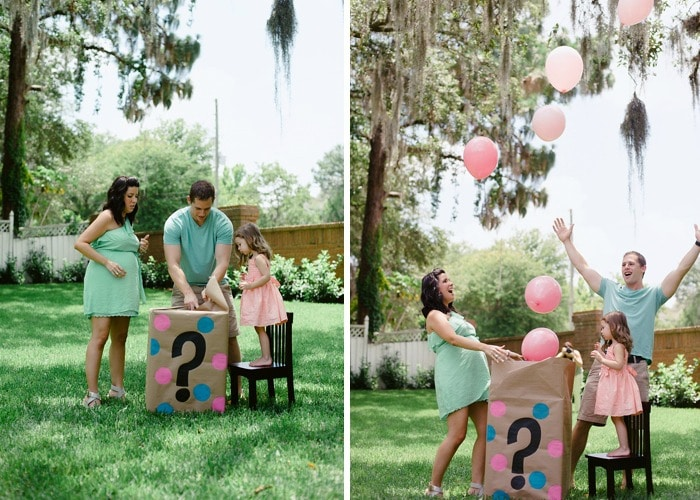 a man, womand and little girl opening a box with a question mark on the side with pink balloons floating out of it is a simple gender reveal idea