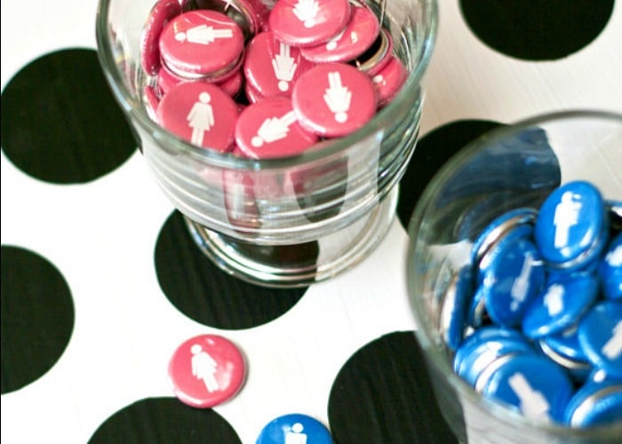 blue and pink buttons in cups are a simple gender reveal party idea
