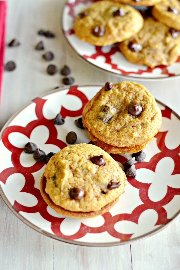 two plates of pumpkin chocolate chip cookies
