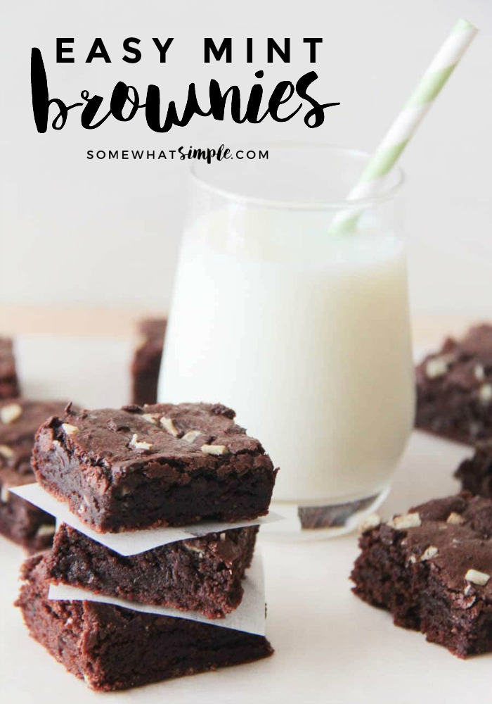 several Creme de Menthe Brownies next to a glass of milk