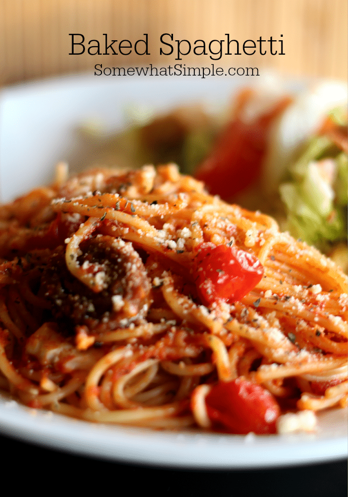 Baked Spaghetti is a tasty twist on a classic meal! A quick and savory meat sauce combined with spaghetti and topped with delicious cheese, then baked in the oven until hot and bubbly! The perfect week-night dinner for family gatherings or potlucks. #spaghetti #spaghettisauce #bakedspaghetti #italianfood #casserole #pasta via @somewhatsimple