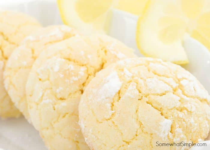 a plate of Lemon Cake Mix Cookies made from this easy recipe with slices of lemon next to them on the plate