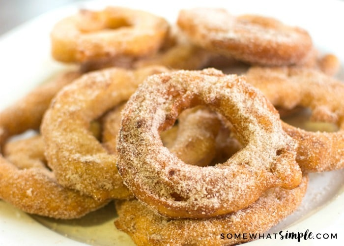 a plate filled with fried apples covered in cinnamon and sugar