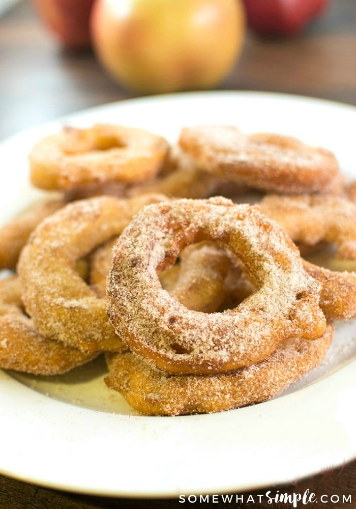 a plate of deep fried apple slices coated with a cinnamon and sugar mixture