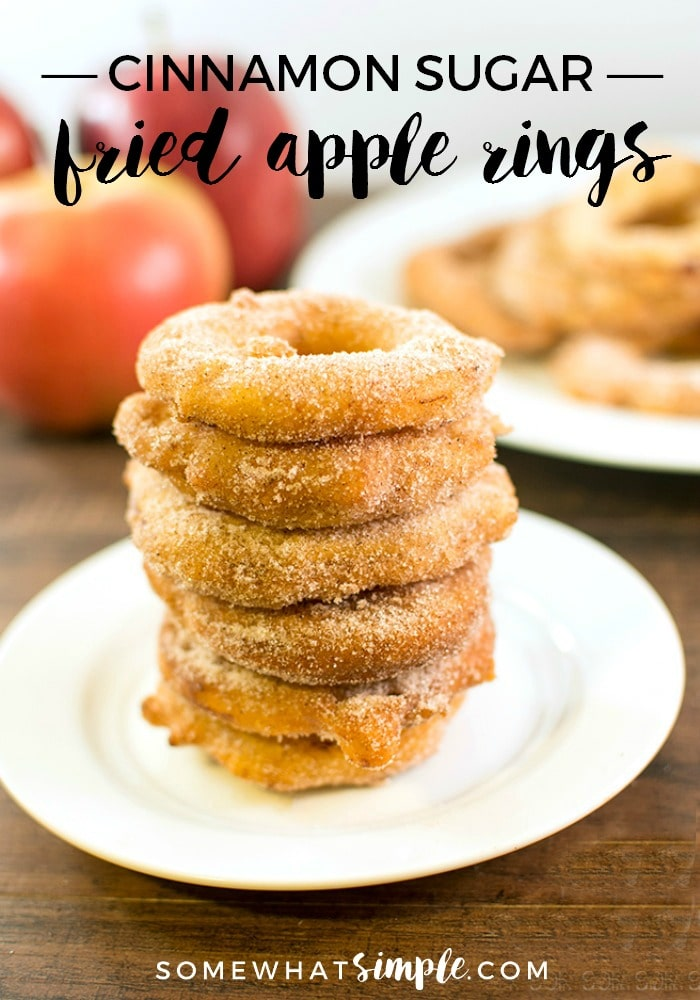 a stack of six cinnamon fried apple rings on a white plate