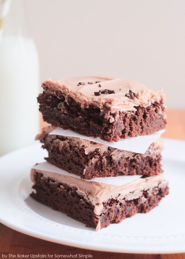 a stack of brownies with hazelnut frosting