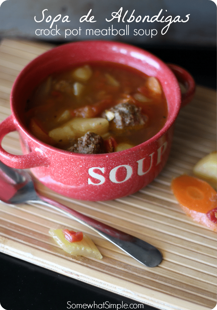 albondigas soup recipe filled with meatballs and fresh vegetables in a red bowl that says soup on it