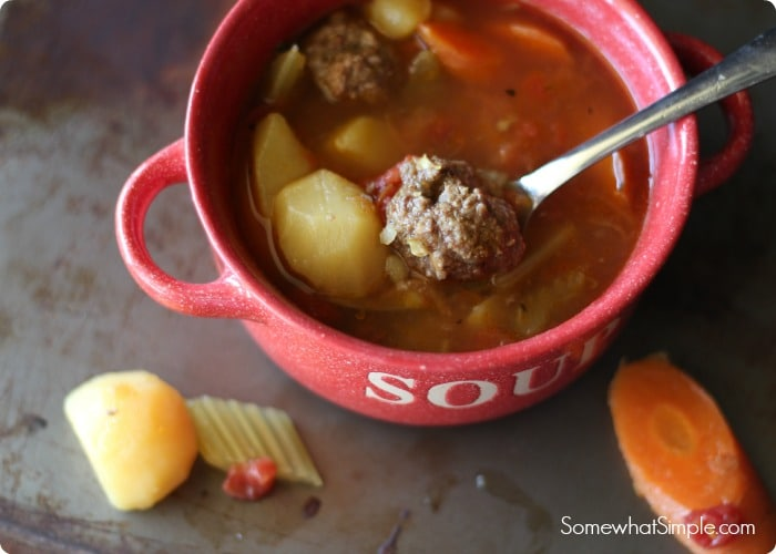 albondigas soup in a bowl with a spoon