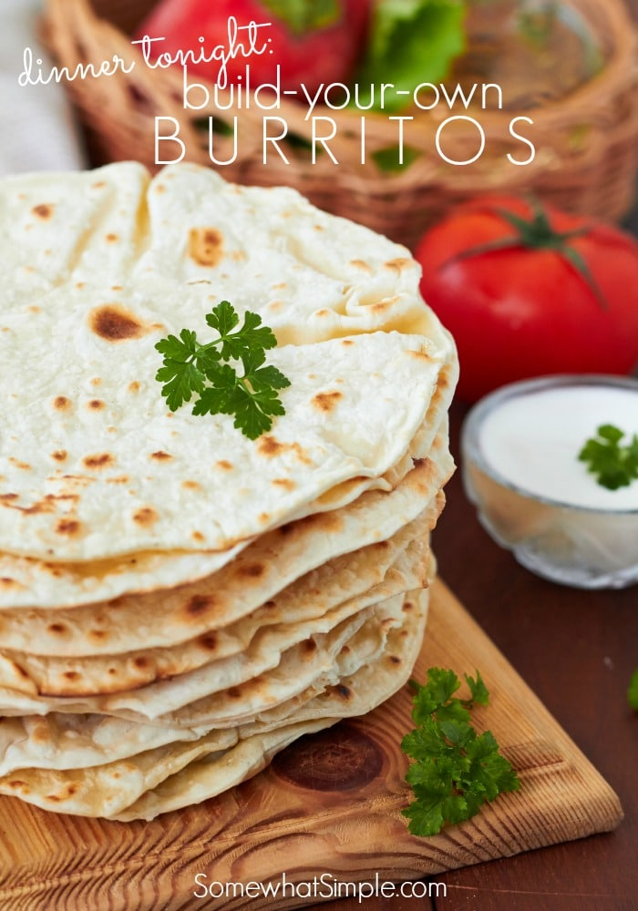 a stack of tortillas and tomatoes in the background with a text overlay that says build your own burritos