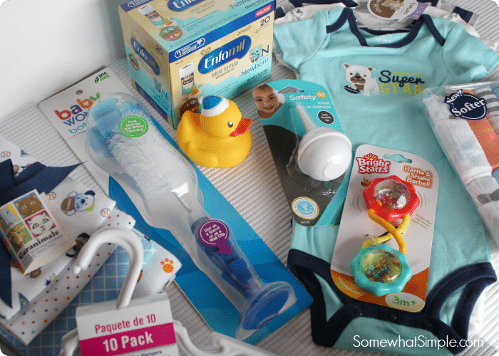 several newborn baby items that will be placed into bags as part of this fun baby shower game