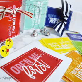 looking down on several brightly colored cards and envelopes that are included in this open when letter printable pack