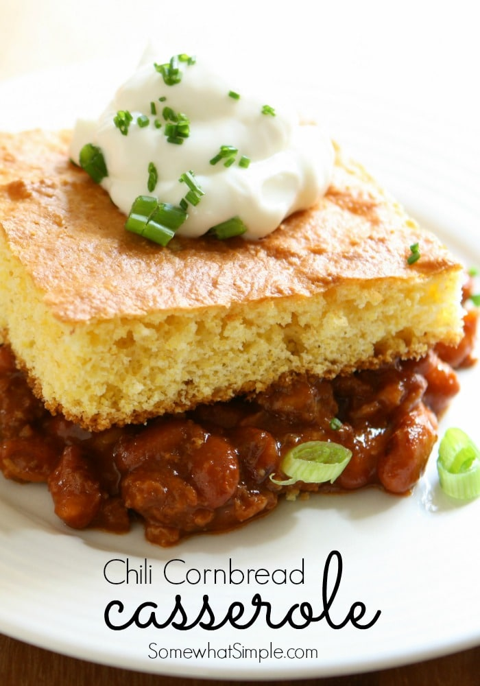 This chili cornbread casserole is the greatest combination to come together since Louis and Vuitton. This easy recipe combines two of my favorite dinner foods into one delicious casserole. #chilicornbreadcasserole #cornbread #easydinner #chilicasserole via @somewhatsimple