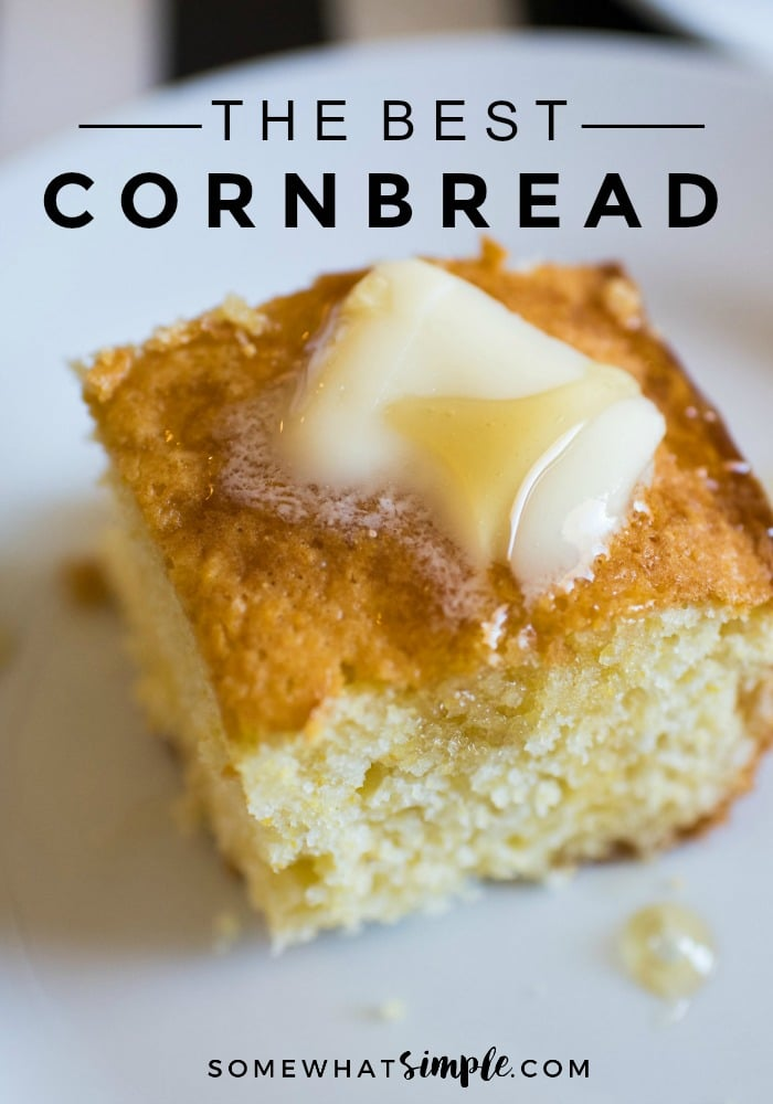 A square of the best cornbread made from cake mix on a white plate and topped with a pad of butter