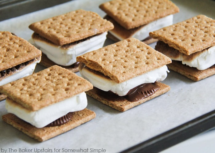 a baking sheet filled will Indoor S'mores that are fresh from the oven
