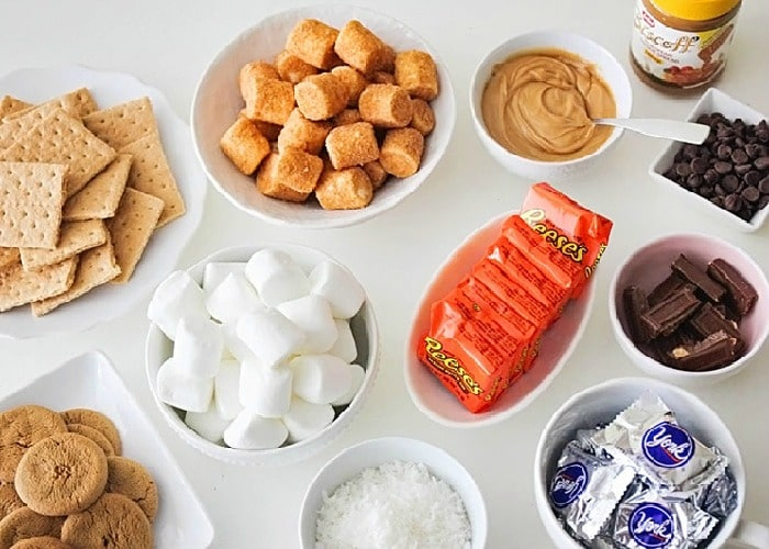 white bowls filled with smores makings is a delicious dessert idea for a bbq
