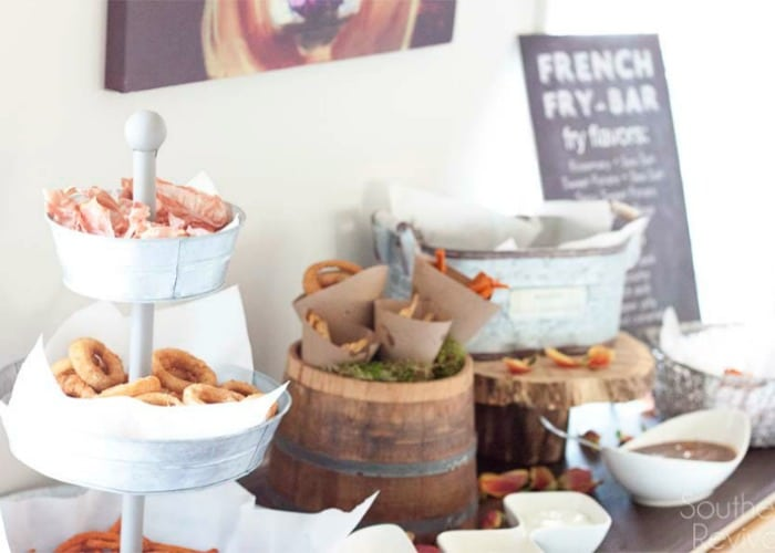 French fry bar set up on a table is a fun idea to display your side dishes at a summer bbq