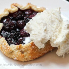 a Blueberry Galette on a plate topped with a scoop of vanilla ice cream