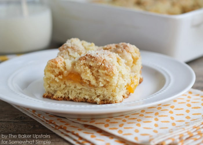 a piece of Peach Streusel Coffee Cake on a white plate