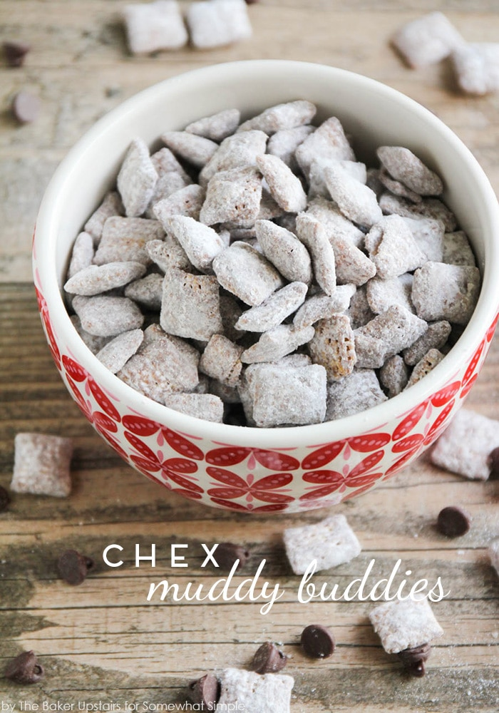 a bowl filled with Chex Muddy Buddies topped with powdered sugar