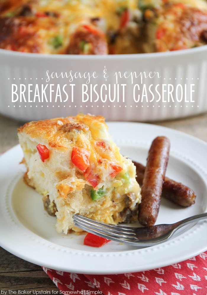 Pepper and Sausage Breakfast Casserole with biscuits on a white plate with 2 sausage links on the side