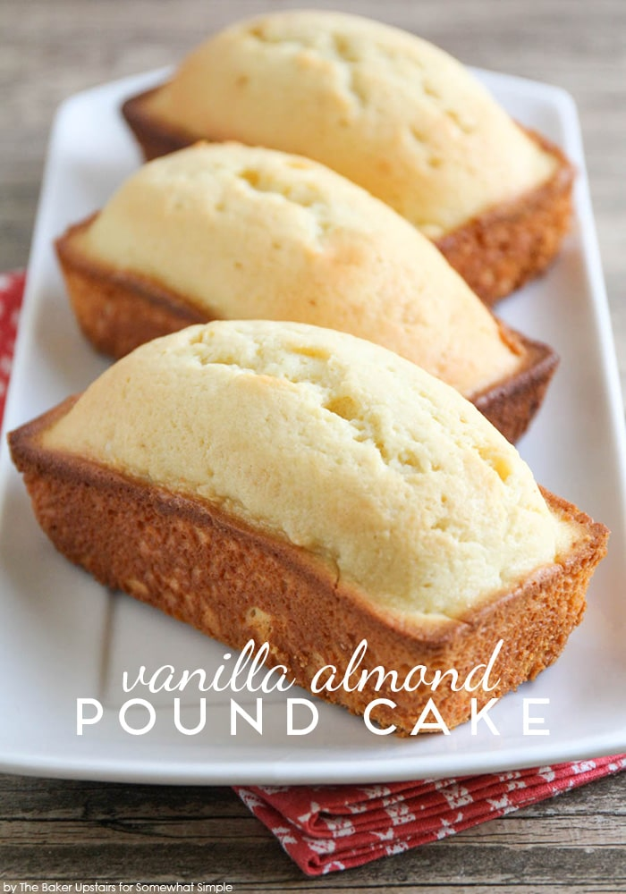 three loaves of Vanilla Almond Pound Cake on a white serving tray