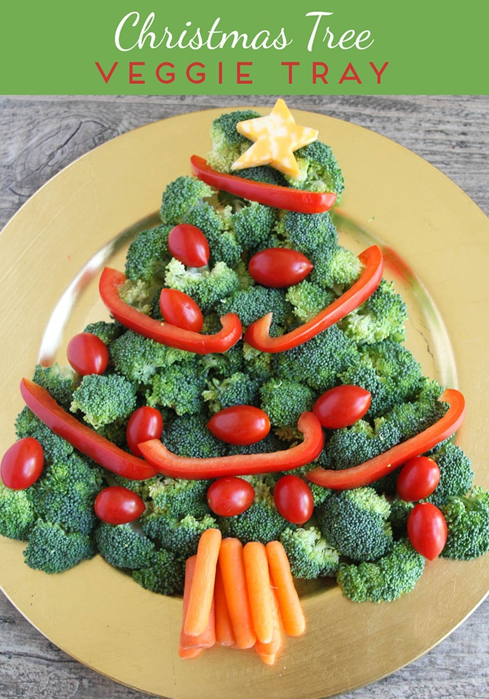 This Christmas tree veggie tray is simple and easy to make. The kids will love helping you arrange the veggies on the tray to make a fun Christmas tree shape that's perfect for the holidays.  #christmastreeveggietray #christmastreeveggietrayidea #christmastreeveggieplatter #christmastreeshapedveggietray #christmasveggietrayideas via @somewhatsimple