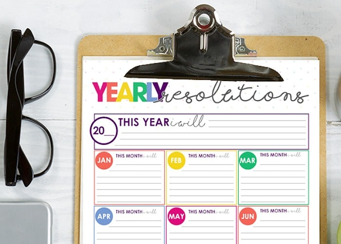New Years Resolution Printable on a clipboard