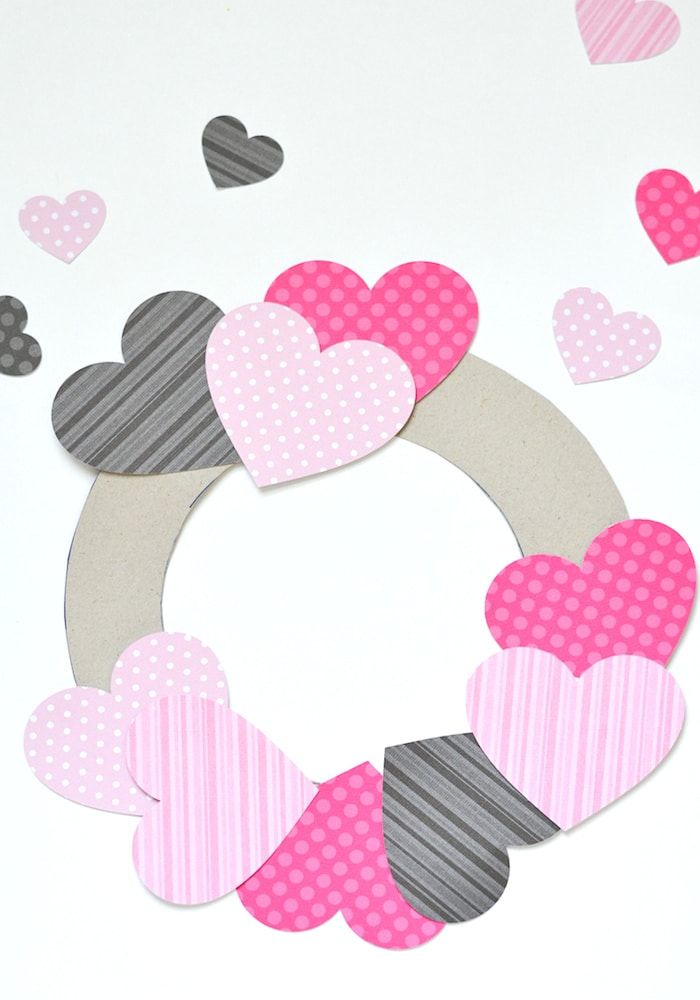 Place scrapbook paper hearts on wreath