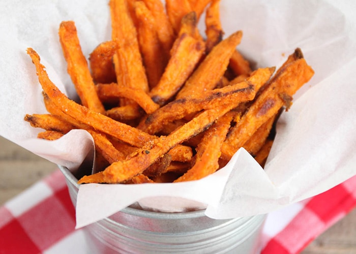 a metal bowl filled with crispy Sweet Potato Fries that were baked in the oven